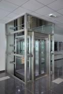 Hydraulický výtah v prosklené ocelové konstrukci